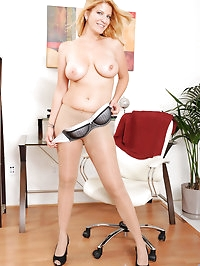 Hot mature blonde strips off her clothes and gently slips..