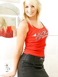 Tall Karla in leather mini and black pantyhose