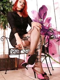 Nadjas long legs and feet covered in thin nylons without..