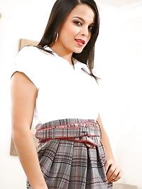 Bebe looks amazing dressed as a secretary. She strips to..