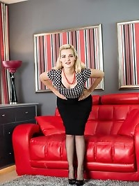 Dolly is in a retro outfit made to thrill and sporting..