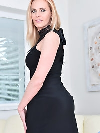 Looking hot in an evening dress, Lili Peterson returns..