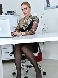 Leggy blonde Afina Kisser shows her secretary style