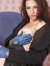 Sexy Milf Tina is in a pair of leather gloves showing her..