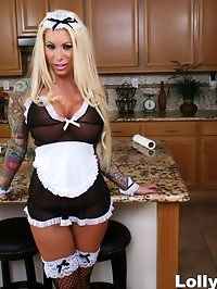 Busty blonde maid Lolly receives a creampie in the kitchen