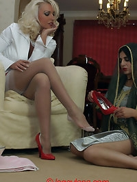Leggy Lana gives her foot masseuse her own foot massage!