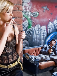 She smokes a cigarette and fucks a vagabond
