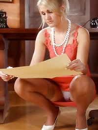 Blonde office babe dressed in stockings and orange dress