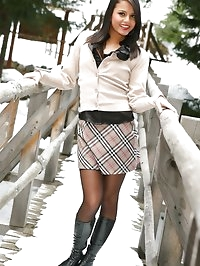 Dark haired beauty in miniskirt, boots and sexy lingerie.