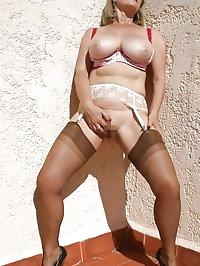 Lusty chick wears stockings under her dress