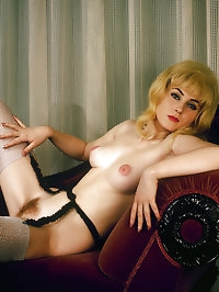 Blonde retro babe in an amazing sexy outfit