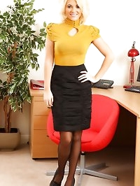 Blonde Emma in yellow office wear and black suspenders