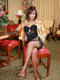Awesome MILf with long legs taking some sexy photos