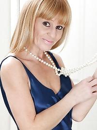 Skinny MILF Penelope slides off her elegant blue dress..