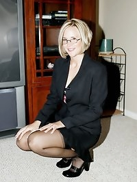 Desirae Stripping Out of Business Suit Stockings