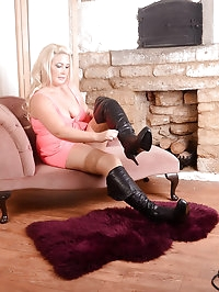 Curvy blonde puts on a sexy black pair of thigh high..