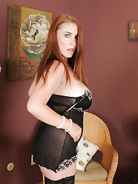 Busty mature redhead Desiree DeLuca parts her stocking..