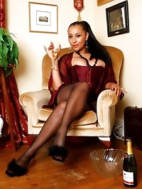 Danica enjoys cold champagne on her stockinged and bare..
