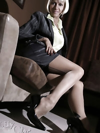 Business lady Lily in stockings under short skirt